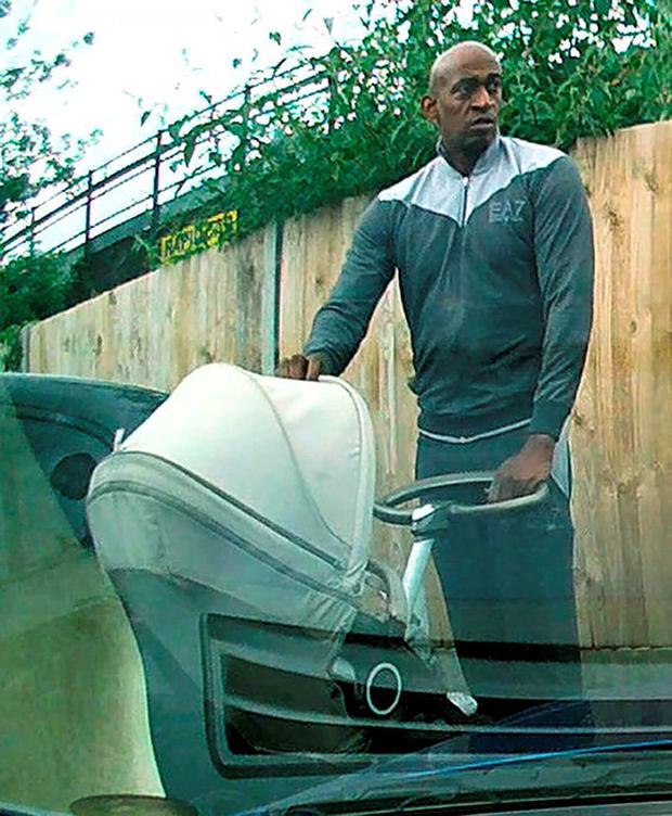 CCTV footage released by police of a man pushing a pram who is suspected of causing £9,000 worth of damage to an Aston Martin car. Photo: Metropolitan Police/PA Wire