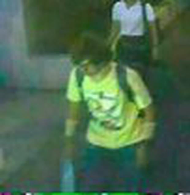 A man wearing a yellow T-shirt and carrying a backpack is seen walking near the Erawan shrine, where a bomb blast killed 22 people on Monday, in Bangkok, Thailand. Photo: Reuters/Thai Police/Handout via Reuters