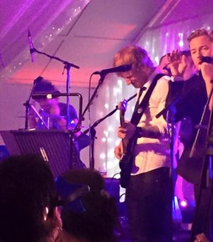 Ed Sheeran performing at Ronan and Storm's wedding in Scotland.