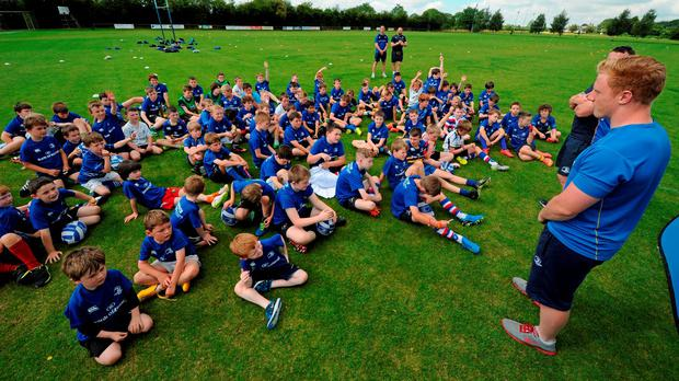 Leinster rugby players Aaron Dundon and James Tracy visited the Bank of Ireland Summer Camp in North Kildare RFC earlier this year: Seb Daly / SPORTSFILE