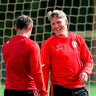 Manchester United's Bastian Schweinsteiger shares a joke with Wayne Rooney during a training session at the Aon Training Complex