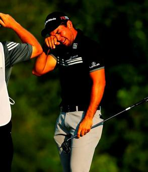 An emotional Jason Day celebrates with his caddie and mentor Colin Swatton after winning the US PGA Championship on Sunday
