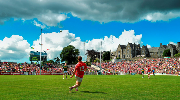 Colm O'Neill kicks a free in the drawn Munster final against Kerry, one of the few games to entertain this summer