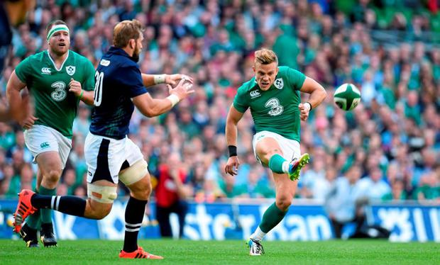 Ian Madigan, Ireland, kicks crossfield to setup Luke Fitzgerald for Ireland's fourth try against Scotland. Picture credit: Stephen McCarthy / SPORTSFILE