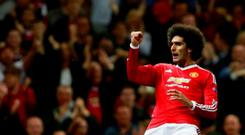 Marouane Fellaini celebrates after scoring the third goal for Manchester United at the death Action Images via Reuters / Jason Cairnduff