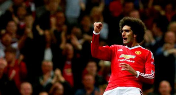 Marouane Fellaini celebrates after scoring the third goal for Manchester United at the death in the first leg Action Images via Reuters / Jason Cairnduff
