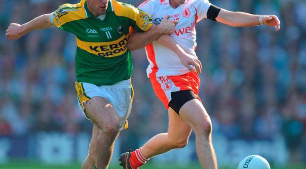 Declan O'Sullivan and Brian Dooher battle for possession in the 2008 final