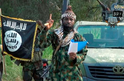 Boko Haram leader, Abubakar Shekau gesturing as he delivers a speech. Photo: AFP/Getty Images