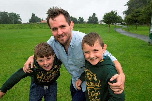 Marcus Dalton who did a skydive in his mother's memory after she died of Cancer pictured with his younger brothers Oisin and Fionn. Pic:Mark Condren 6.8.2015