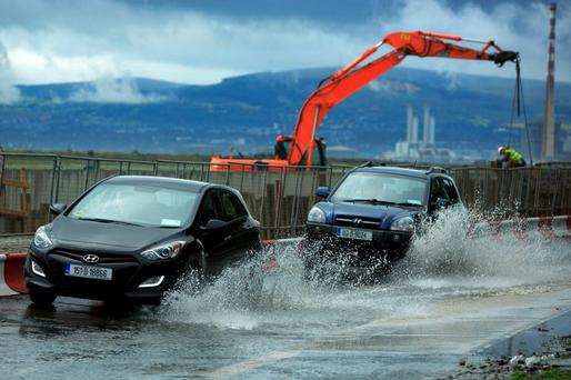 Cars are caught in flood waters on the Clontarf Road in Dublin Photo: Gareth Chaney/Collins