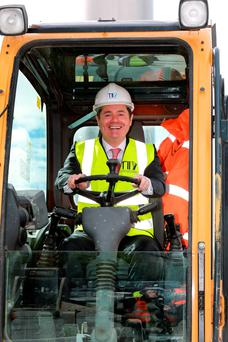 Minister for Transport, Tourism and Sport Paschal Donohoe on a digger at the commencement of the main Luas cross-city track