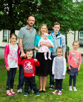 Mark and Karen O'Connell with their children ranging from 5 months to 14 years, Katie, Damien, Aimee, Dylan, Emma and Erin. Picture: Garry O'Neill