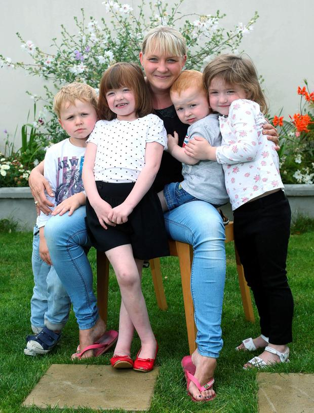 Lucinda Carty, with her children from left, Mark, 3, Alexandra, 7, James, 1 and Chloe, 5 at their home. Picture credit; Damien Eagers 14/8/2015