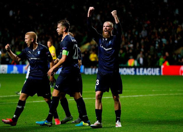 Jo Inge Berget celebrates after scoring the late second goal for Malmo
