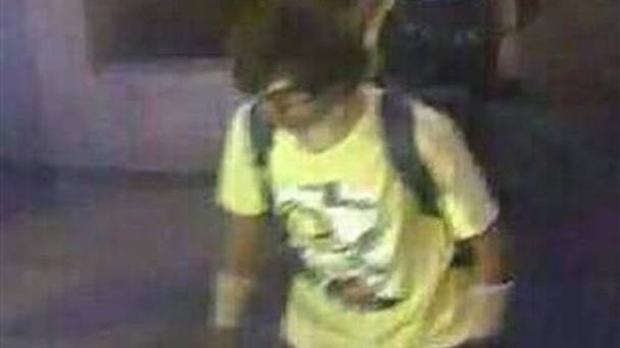 Image released by Thai police shows a man wearing a yellow T-shirt near the Erawan Shrine before an explosion occurred in Bangkok, Thailand.