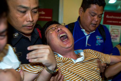 Chinese national Gao Yu Ping, who lost his wife and daughter in Monday's deadly blast, cries at the Institute of Forensic Medicine in Bangkok, Thailand. Reuters/Athit Perawongmetha