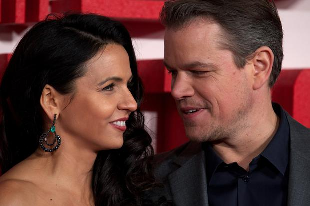 US actor Matt Damon (R) and poses on the red carpet with his wife, Argentina-born Luciana Barroso (L)