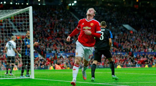 Manchester United's Wayne Rooney looks dejected