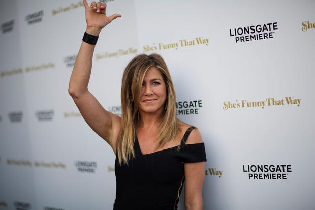 Cast member Jennifer Aniston gestures at fans at the premiere of