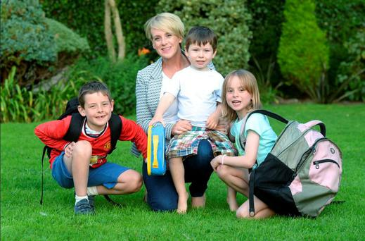 TV presenter Sybil Mulcahy at home with her three kids Genevieve (7), Hugh (9) and Michael (3) as they prepare for the new school year