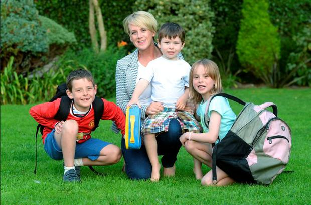 TV presenter Sybil Mulcahy at home with her three kids Genevieve (7), Hugh (9) and Michael (3)