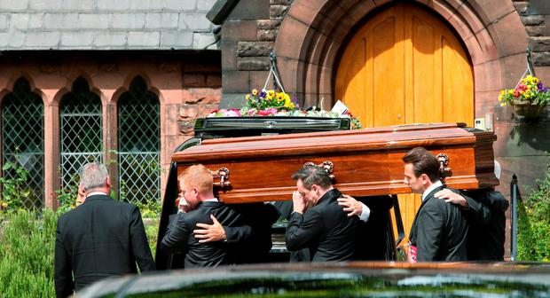 The coffin of Cilla Black arrives at St Mary's Church in Woolton, Liverpool, ahead of her funeral service. Photo: Peter Byrne/PA Wire