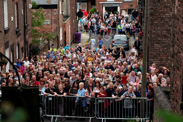 The crowd outside St Mary's Church in Woolton, Liverpool, ahead of the funeral service of Cilla Black. Photo: Peter Byrne/PA Wire