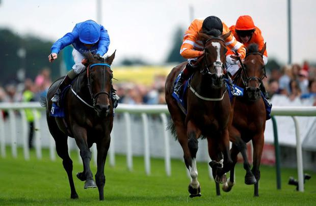 Kevin Manning riding Pleascach (L) win The Darley Yorkshire Oaks at York