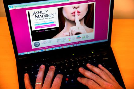 The Ashley Madison website has promised no strings, '100pc discreet' sex, but 115,000 clients could be exposed by a breach of the website security with millions of email addresses of those registered now available online. Photo: Carl Court.