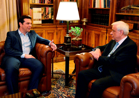 Greek Prime Minister Alexis Tsipras talks to the President of Greece Prokopis Pavlopoulos at the Presidental Palace in Athens yesterday Photo: Getty