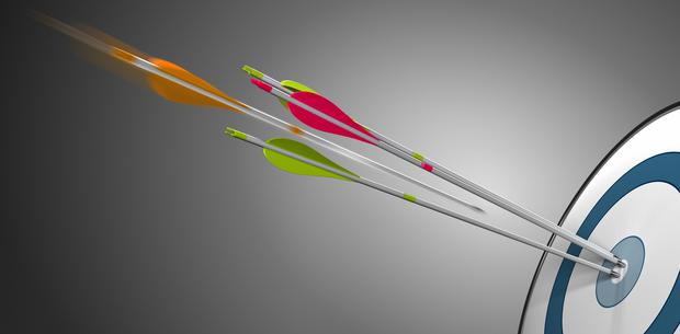 Three arrow hitting a target bullseye plus an orange one in motion about to hit the center. Concept image for competitiveness or business performance.