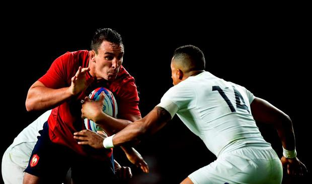 Louis Picamoles of France takes on Anthony Watson of England during the QBE International match between England and France at Twickenham