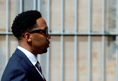 Grandson of former South African president Nelson Mandela, Ndaba Mandela walks out of the magistrates court where his brother Mbuso Mandela is scheduled to appear accused of raping a 15-year-old girl, in Johannesburg, South Africa, Friday, Aug. 21, 2015. (AP Photo/Themba Hadebe)