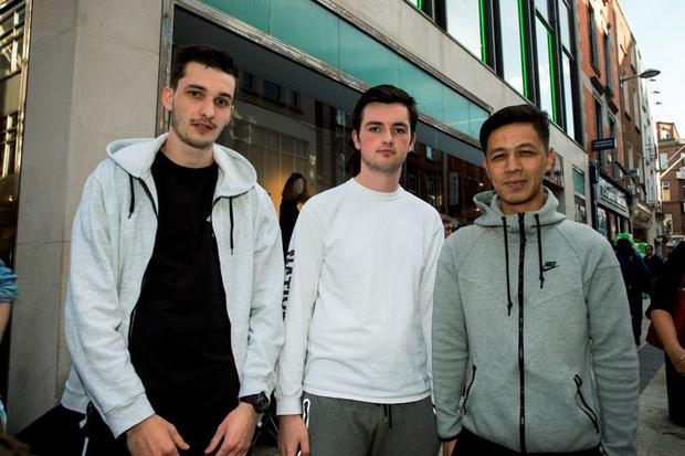 21/8/15 Cian McDonagh (left), Ballymun, Jason Menton, Finglas and Simon Wai, Marino, queuing outside BT2's shop on Grafton street for Kanye West Sneakers, which go on sale on Saturday morning. Picture:Arthur Carron