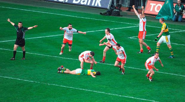 Tyrone players celebrate as referee Maurice Deegan blows the full time whistle in the 2008 All-Ireland final