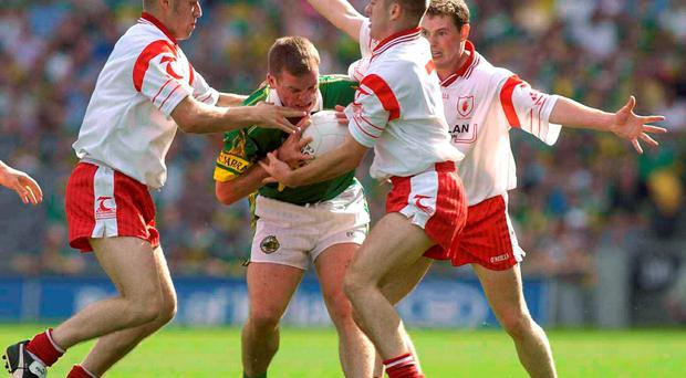 Unfinished business: 2003 - Tyrone 0-13 Kerry 0-6. Dara O'Cinneide, Kerry, in action against Tyrone players, left to right, Gavin Devlin, Philip Jordan and Ryan McMenamin