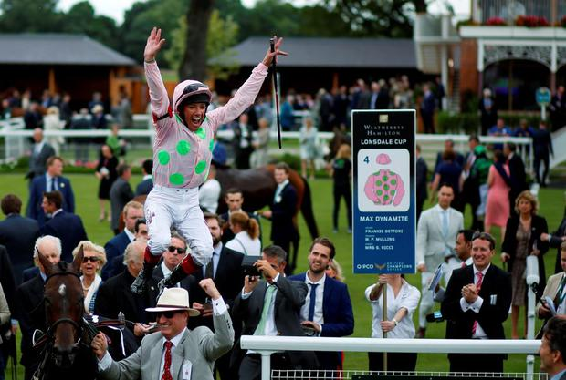 Rich Ricci clenches a fist in delight as Frankie Dettori celebrates in trademark fashion after partnering Max Dynamite to victory at York yesterday