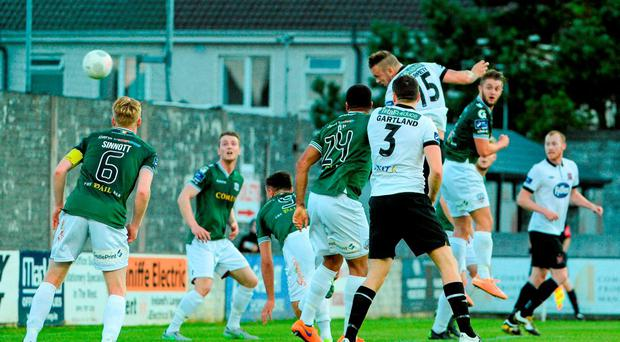 Paddy Barrett rises highest to put away Dundalk's third goal