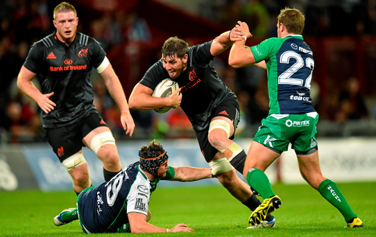 Munster's Dave O'Callaghan is tackled by Quinn Roux and Craig Ronaldson