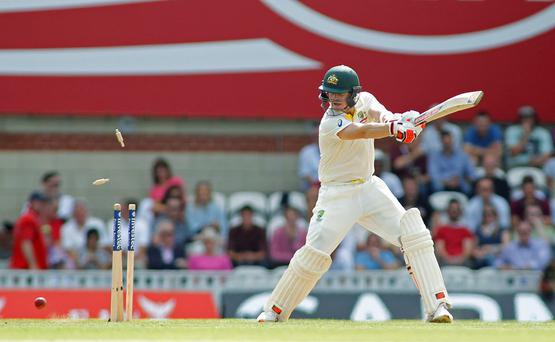 Australia's Steve Smith is bowled out by England's Steven Finn during day two of the Ashes