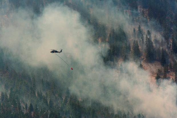 A Blackhawk military helicopter fights the First Creek Fire in Chelan, Washington August 21, 2015. REUTERS/Jason Redmond
