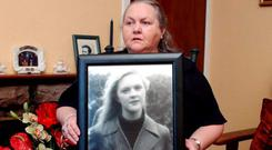 Josephine Pender with a photo of missing daughter Fiona