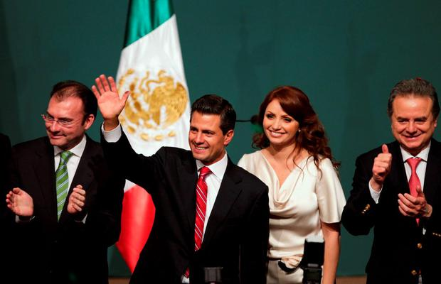 Pena Nieto, presidential candidate of the Institutional Revolutionary Party, celebrates next to his wife Rivera, campaign manager Videgaray and President of the PRI party Coldwell after exit polls showed him in first place, in Mexico City