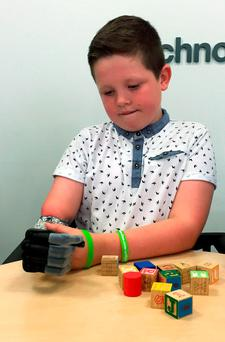 Josh Cathcart, nine, from Dalgety Bay, Fife, who has become the first boy in the UK to be fitted with a child-sized bionic hand Credit: Mark McLaughlin/PA Wire