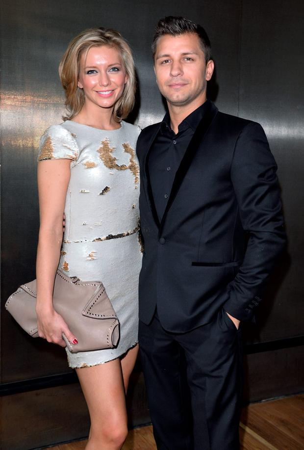 LONDON, ENGLAND - SEPTEMBER 13: Rachel Riley and Pasha Kovalev attend the Julien Macdonald show during London Fashion Week Spring Summer 2015 on September 13, 2014 in London, England. (Photo by Karwai Tang/WireImage)
