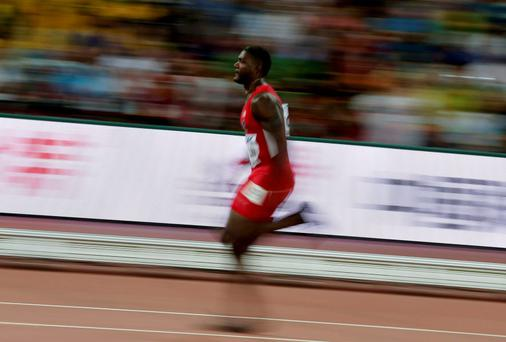 Justin Gatlin of the U.S. competes in the men's 100 metres heats during the 15th IAAF World Championships at the National Stadium in Beijing