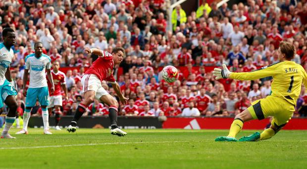 Newcastle United's Tim Krul saves a shot from Javier Hernandez at Old Trafford today.