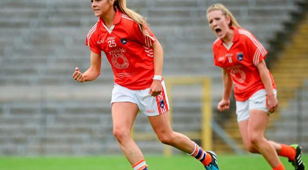 Armagh's Aoife Lennon celebrates scoring her sides first goal, with team-mate Kelly Mallon, right.