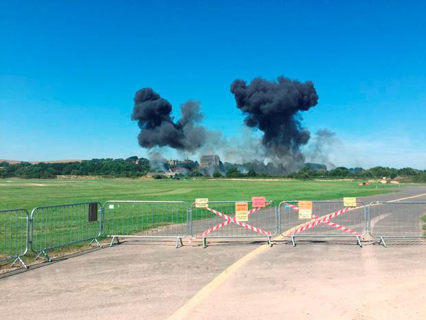BEST QUALITY AVAILABLE Handout photo taken with permission from the Twitter feed of @NDH37087 of smoke following a crash involving a plane near Shoreham Airshow in West Sussex. Emergency services are at the scene on the A27. @NDH37087/PA Wire