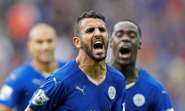 Riyad Mahrez celebrates after scoring the first goal for Leicester